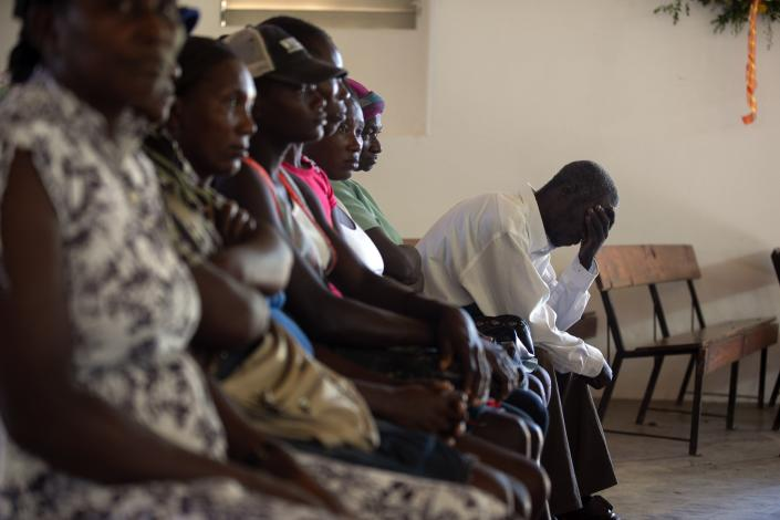 Cholera survivors attend Mass at a Catholic church to commemorate 10 years since the cholera outbreak in Mirebalais, Haiti, Monday, Oct. 19, 2020. Ten years after a cholera epidemic swept through Haiti and killed thousands, families of victims still struggle financially and await compensation from the United Nations as many continue to drink from and bathe in a river that became ground zero for the waterborne disease. (AP Photo/Dieu Nalio Chery)