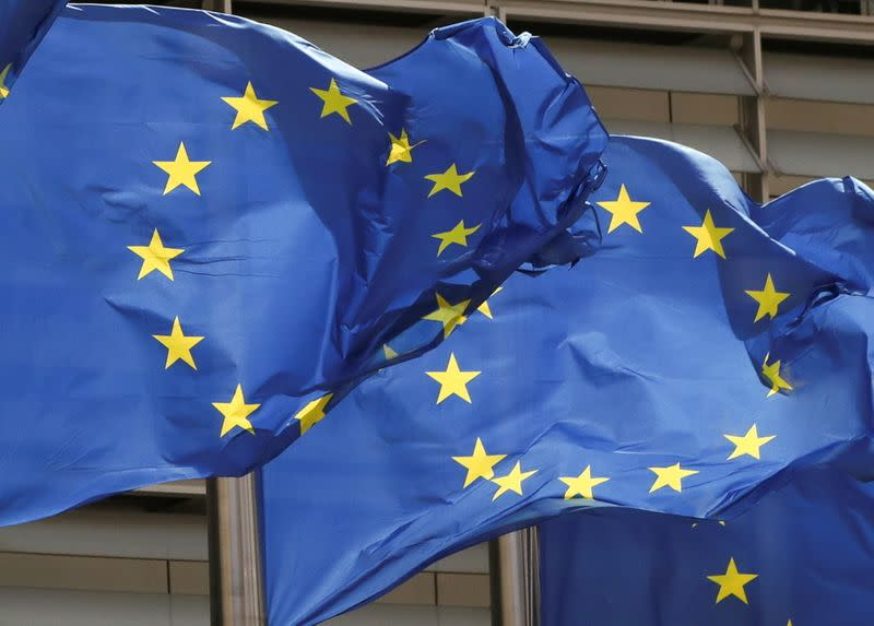 FILE PHOTO: European Union flags flutter outside the EU Commission headquarters in Brussels