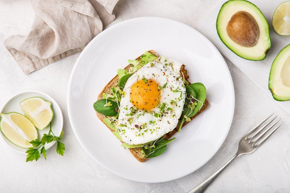 """<p>Full of vitamins A, D, and B12, <a href=""""https://www.goodhousekeeping.com/health/diet-nutrition/a48023/egg-nutrition/"""" rel=""""nofollow noopener"""" target=""""_blank"""" data-ylk=""""slk:eggs"""" class=""""link rapid-noclick-resp"""">eggs</a> are an inexpensive and nutrient-dense ingredient. Two large <a href=""""https://www.goodhousekeeping.com/food-recipes/easy/g428/easy-egg-recipes/"""" rel=""""nofollow noopener"""" target=""""_blank"""" data-ylk=""""slk:eggs"""" class=""""link rapid-noclick-resp"""">eggs</a> contain more than 50% of the choline you need each day, which affects memory, mood, and muscle control. Just one egg has about 8 grams of protein as well. Nearly <em>everything</em> in our bodies requires protein, such as our skin, blood, and bones. Protein takes longer to digest than carbs, keeping you fuller, longer. Make breakfast a combo of filling fiber and lean protein, like scrambled eggs on whole-grain toast with sliced tomato or a spinach-broccoli-mushroom omelet. Or grab a couple of <a href=""""https://www.goodhousekeeping.com/food-recipes/cooking/tips/a19189/cooking-perfect-hard-boiled-eggs/"""" rel=""""nofollow noopener"""" target=""""_blank"""" data-ylk=""""slk:hard-boiled eggs"""" class=""""link rapid-noclick-resp"""">hard-boiled eggs</a> if you're on the go. </p>"""