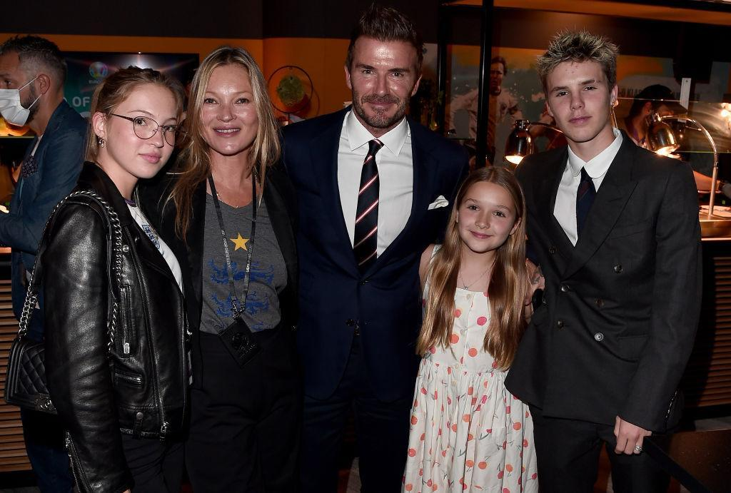 David Beckham is going to miss his daughter Harper, when she goes back to school, pictured in July 11, 2021 with Cruz Beckham, Kate Moss and her daughter Lila Moss. (Getty Images)