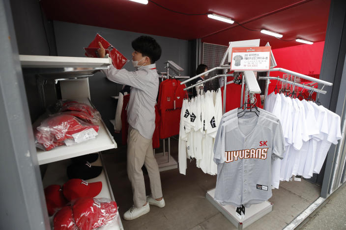 SK Wyverns' merchandise is displayed for sale before a start of baseball game between Hanwha Eagles and SK Wyverns in Incheon, South Korea, Tuesday, May 5, 2020. Cheerleaders danced beneath rows of empty seats and umpires wore protective masks as a new baseball season began in South Korea. After a weeks-long delay because of the coronavirus pandemic, a hushed atmosphere allowed for sounds like the ball hitting the catcher's mitt and bats smacking the ball for a single or double to echo around the stadium. (AP Photo/Lee Jin-man)
