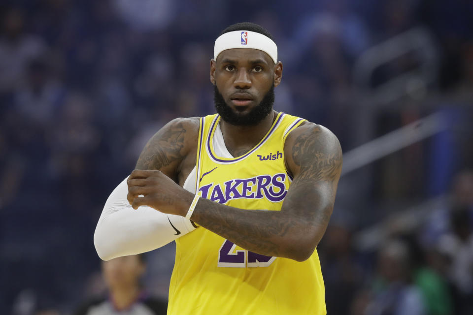 Los Angeles Lakers forward LeBron James (23) against the Golden State Warriors during the first half of a preseason NBA basketball game in San Francisco, Saturday, Oct. 5, 2019. (AP Photo/Jeff Chiu)