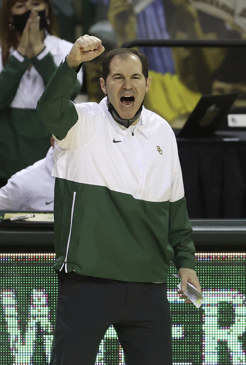 FILE - Baylor head coach Scott Drew reacts as his team scores in the second half of an NCAA college basketball game against Texas Tech in Waco, Texas, in this Sunday, March 7, 2021, file photo. Nobody will get a lump in their throat or start sizing up glass slippers for programs like these Alabama, Illinois, Baylor. They're not underdogs. They're hardly unknown. What they are is a group of new teams with well-recognized names in the NCAA Tournament, and they're hoping to keep making life hard on the programs that have long had a stranglehold on March.(AP Photo/Jerry Larson, File)