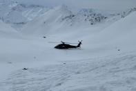 The wreckage of a helicopter which crashed, killing five people including Petr Kellner in Alaska