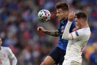 Italy's Ciro Immobile, left, and Spain's Aymeric Laporte vie for the ball during the Euro 2020 soccer semifinal match between Italy and Spain at Wembley stadium in London, Tuesday, July 6, 2021. (Laurence Griffiths, Pool via AP)