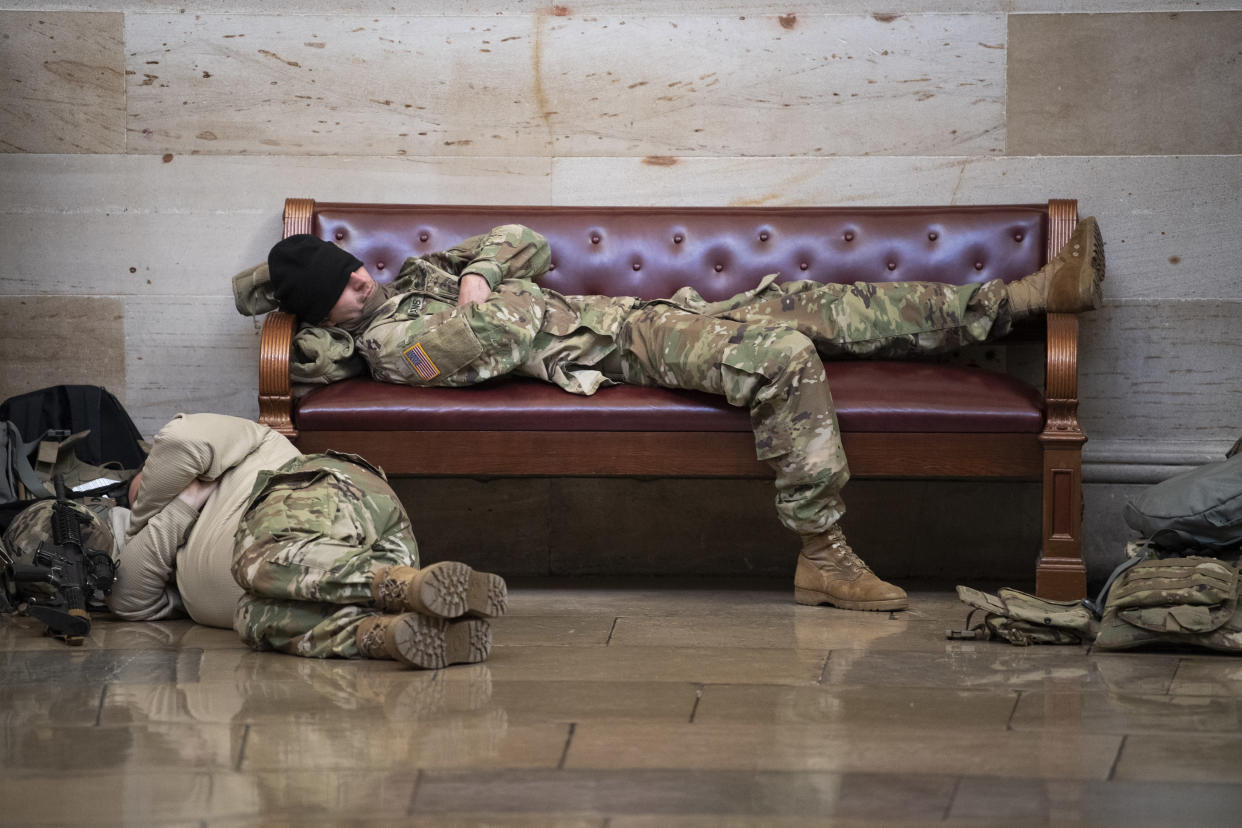 Members of the National Guard rest in the Rotunda of the Capitol