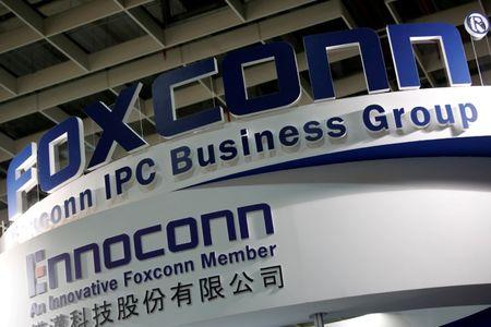 FILE PHOTO: Logos of Foxconn and Ennoconn are seen during the annual Computex computer exhibition in Taipei