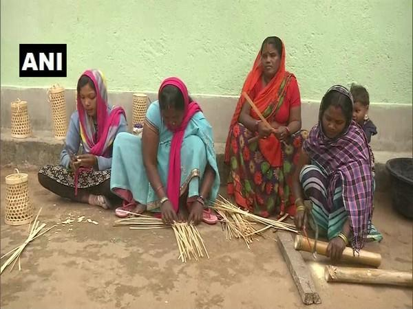 Jitan Devi along with other women making products from bamboo in her village in Ranchi. (Photo/ANI)
