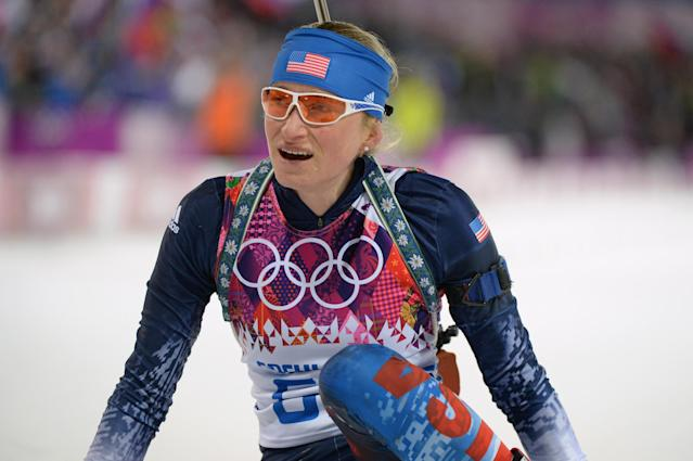 SOCHI, RUSSIA - FEBRUARY 09: Hannah Dreissigacker of United States collapses at the finish line in the Women's 7.5 km Sprint during day two of the Sochi 2014 Winter Olympics at Laura Cross-country Ski & Biathlon Center on February 9, 2014 in Sochi, Russia. (Photo by Harry How/Getty Images)