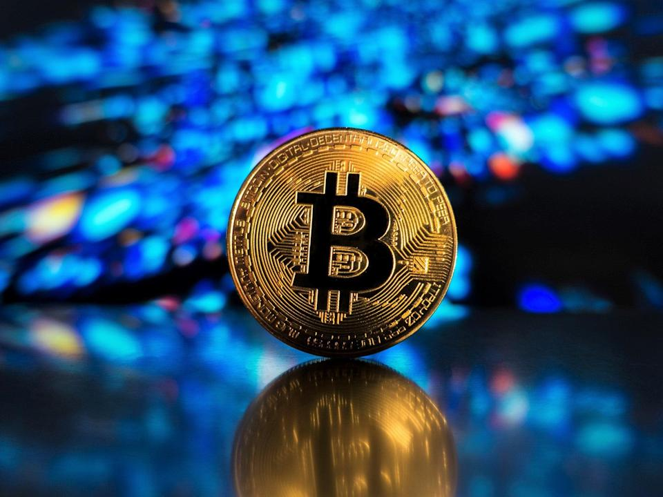 Bitcoin, cardano, dogecoin and ethereum have all hit record price highs in 2021 (Getty Images)