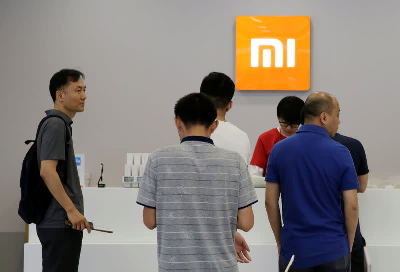 Customers wait to pay at a Xiaomi store in Beijing