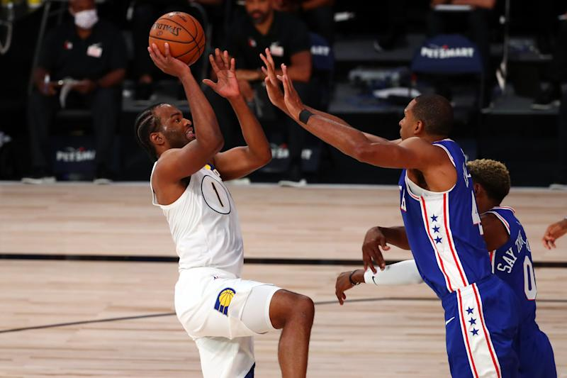 T.J. Warren #1 of the Indiana Pacers shoots the ball against Al Horford #42 of the Philadelphia 76ers.