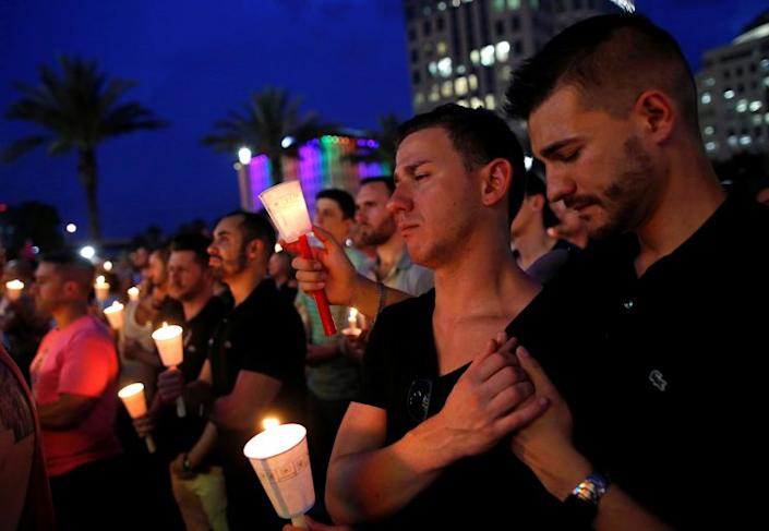 A candlelight vigil on June 13 for the victims of the shootings at the Pulse nightclub in Orlando, Fla. (Photo: Reuters/Jim Young)
