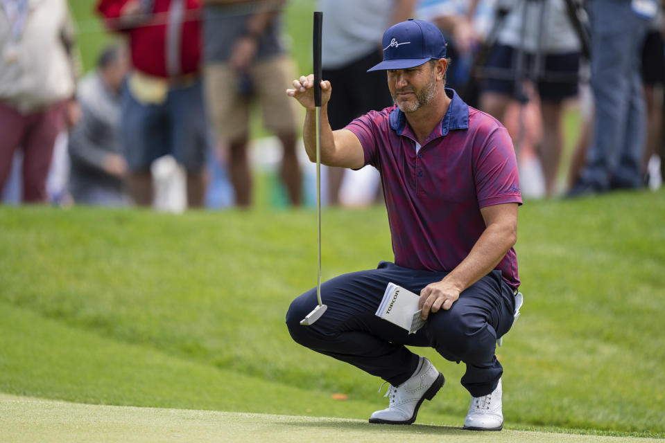 Scott Piercy lines up his putt on the first hole during the third round of the Wells Fargo Championship golf tournament at Quail Hollow on Saturday, May 8, 2021, in Charlotte, N.C. (AP Photo/Jacob Kupferman)