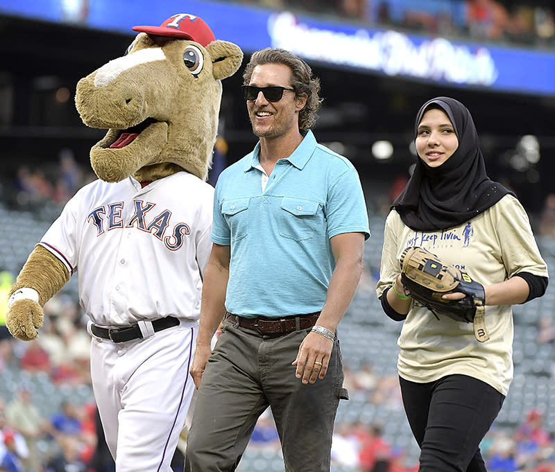 <p>The native Texan took the field at a Texas Rangers baseball game, along with the high school student who tossed out the first pitch and the team mascot, at a game against the Seattle Mariners. (Photo: Max Faulkner/Fort Worth Star-Telegram/TNS via Getty Images) </p>