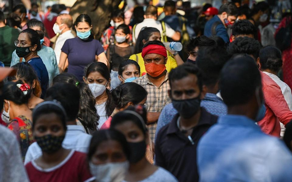 Shoppers flocked to Sarojini Nagar market on Saturday after authorities eased a lockdown in New Delhi - PRAKASH SINGH/AFP