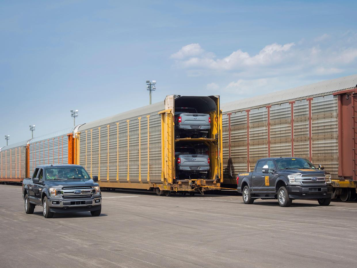 Ford's pick-up towing train full of F-150s.