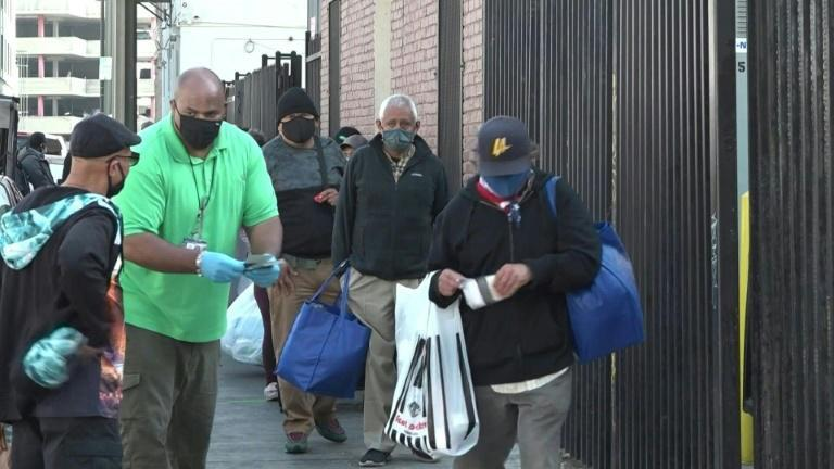 Despite the Covid-19 pandemic, the Los Angeles Mission maintains its annual food distribution to help feed those struggling to make ends meet on Thanksgiving