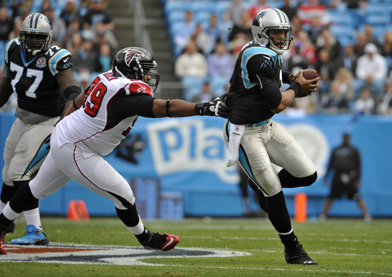 Carolina Panthers' Cam Newton (1) scrambles for a gain as Atlanta Falcons' Vance Walker (99) chases during the first half of an NFL football game in Charlotte, N.C., Sunday, Dec. 9, 2012. (AP Photo/Rainier Ehrhardt)