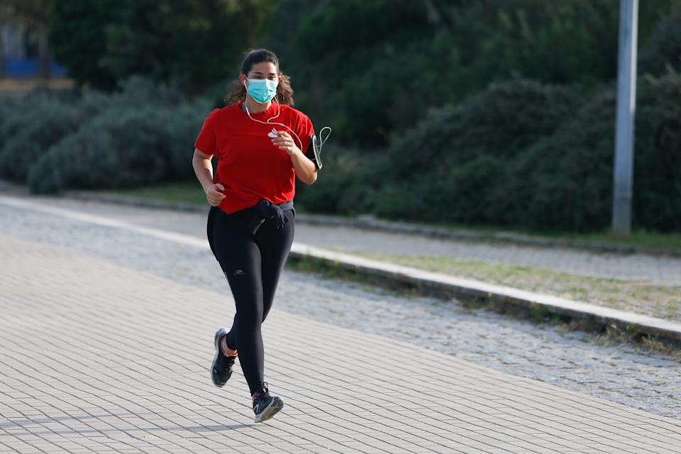 A woman running at the Parque das Nações wearing a mask, Lisbon, Portugal, 29th March, 2020.  Europe has become the epicenter of the COVID-19 outbreak, with one-third of globally reported cases now stemming from the region. (Photo by Valter Gouveia/NurPhoto via Getty Images)