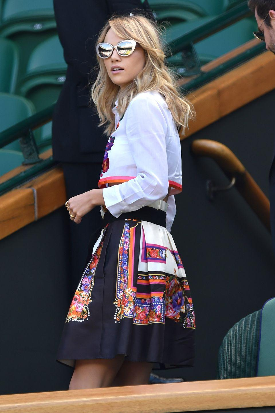 <p><strong>2014</strong> Suki Waterhouse looked cool in a colourful cropped shirt and skirt.</p>