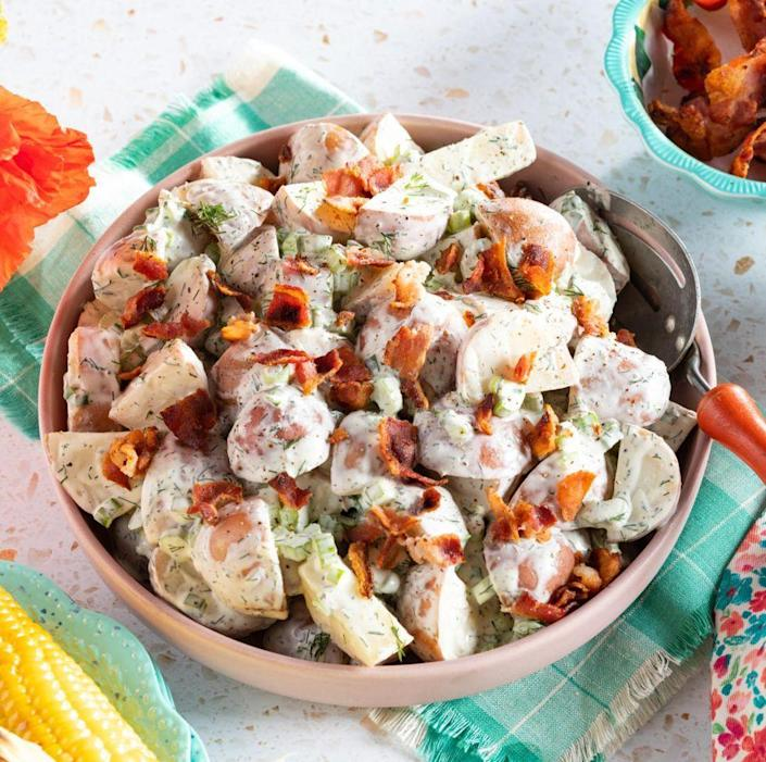 """<p>No cookout is complete without a classic potato salad. This one has all the elements we love about potato salad (creamy dressing and fresh dill), plus so much more (hello, crunchy bacon bits!). </p><p><a href=""""https://www.thepioneerwoman.com/food-cooking/recipes/a35888627/red-potato-salad/"""" rel=""""nofollow noopener"""" target=""""_blank"""" data-ylk=""""slk:Get the recipe."""" class=""""link rapid-noclick-resp""""><strong>Get the recipe. </strong></a></p><p><a class=""""link rapid-noclick-resp"""" href=""""https://go.redirectingat.com?id=74968X1596630&url=https%3A%2F%2Fwww.walmart.com%2Fsearch%2F%3Fquery%3Dpioneer%2Bwoman%2Bserving%2Bbowls&sref=https%3A%2F%2Fwww.thepioneerwoman.com%2Ffood-cooking%2Fmeals-menus%2Fg36353420%2Ffourth-of-july-side-dishes%2F"""" rel=""""nofollow noopener"""" target=""""_blank"""" data-ylk=""""slk:SHOP SERVING BOWLS"""">SHOP SERVING BOWLS</a></p>"""