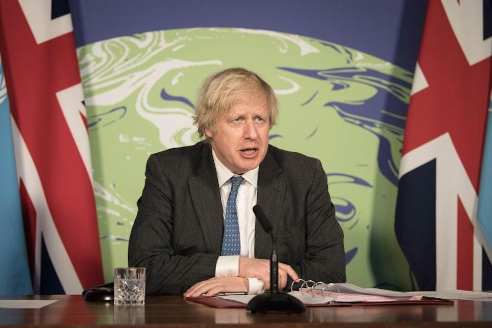 Prime Minister Boris Johnson chairs a session of the UN Security Council on climate and security at the Foreign, Commonwealth and Development Office on 23 February, 2021 (Getty)