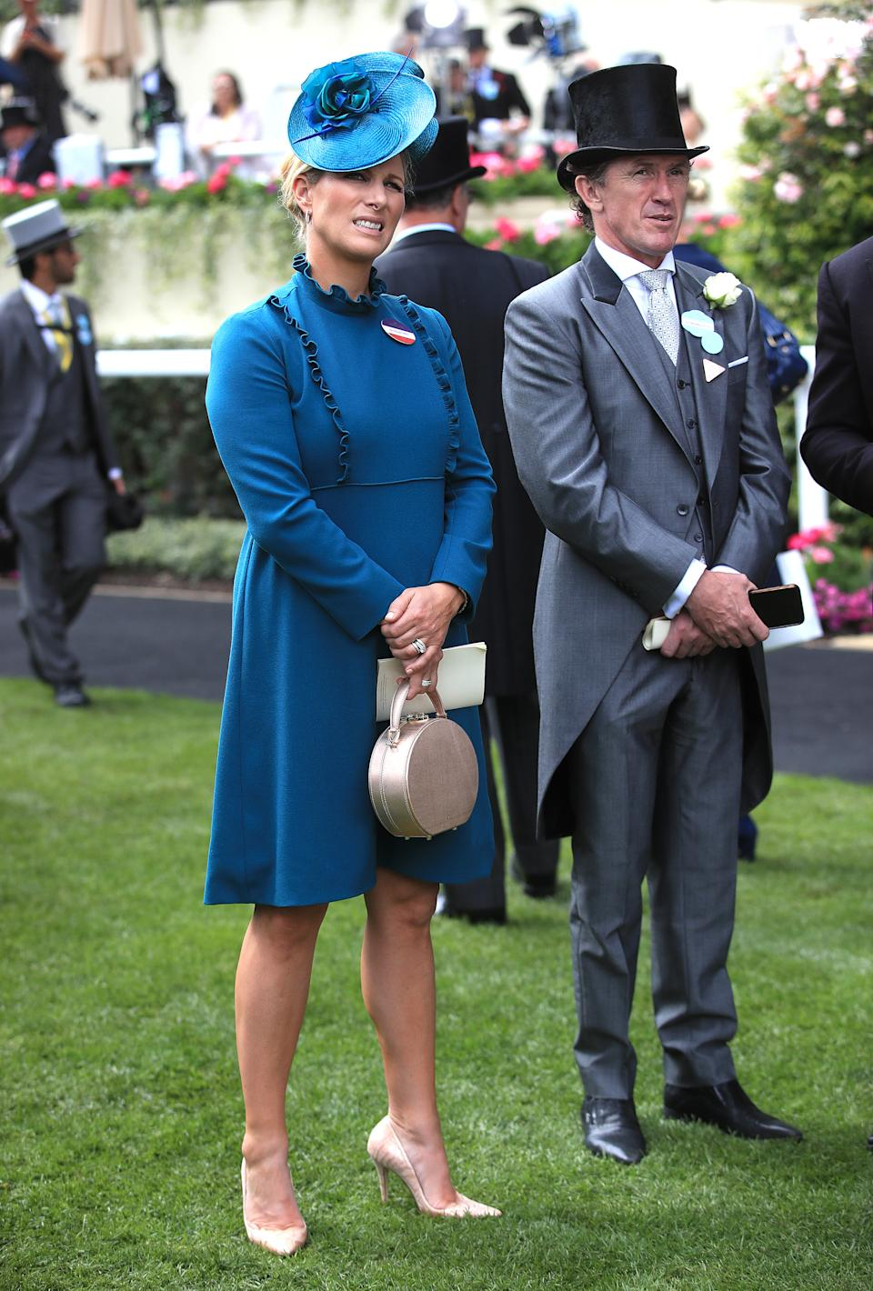 Zara Tindall wore a high neck teal dress with ruffle detailing by Claire Mischevani and a matching hat by Juliette Botterill. <em>[Photo: PA]</em>