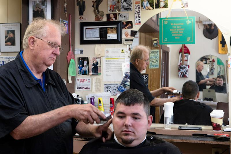 Josh Skidmore has his hair cut by Herald Montgomery, County Commissioner, at Montgomery Barber Shop in Gallipolis, Ohio, on Thursday, Sept. 12, 2019. Montgomery is a republican County Commissioner who supports Donald Trump.
