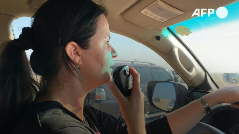In Qatar's desert, a trailblazing woman breaks into the all-male world of off-road driving
