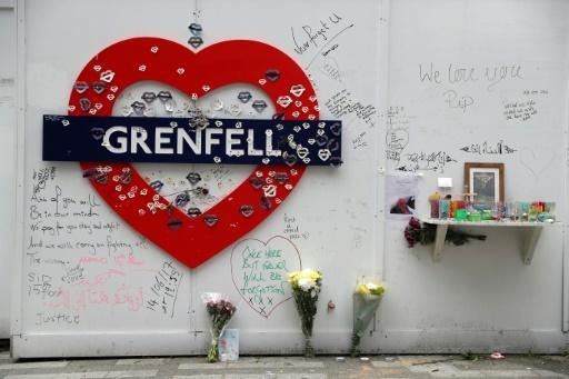 Messages of condolence can be seen near Grenfell tower