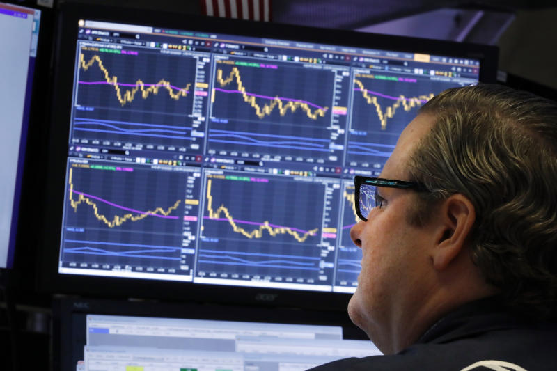 FILE - In this Tuesday, March 10, 2020, file photo, specialist Gregg Maloney works on the floor of the New York Stock Exchange. (AP Photo/Richard Drew, File)