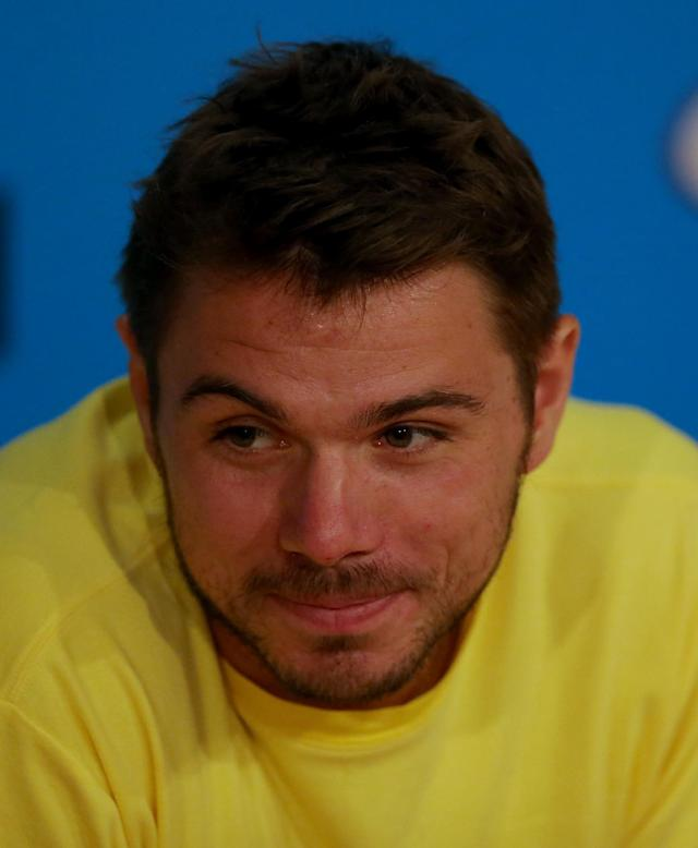 Switzerland's Stanislas Wawrinka answer's questions at a press conference at the Australian Open tennis championship in Melbourne, Australia, Saturday, Jan. 25, 2014. Wawrinka will play Spain's Rafael Nadal in the men's singles final Sunday. (AP Photo/Eugene Hoshiko)