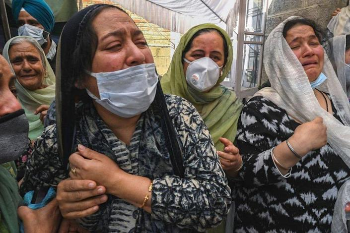Relatives of slain government school principal Supinder Kour mourns during a funeral procession in Srinagar on October 8, 2021, a day after suspected anti-India militants shot dead two school teachers in Indian-administered Kashmir.