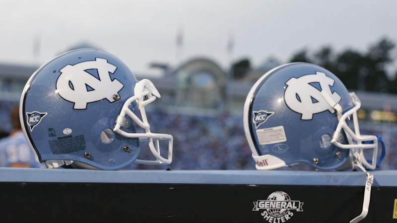 Former agent pleads guilty to giving cash to North Carolina football players