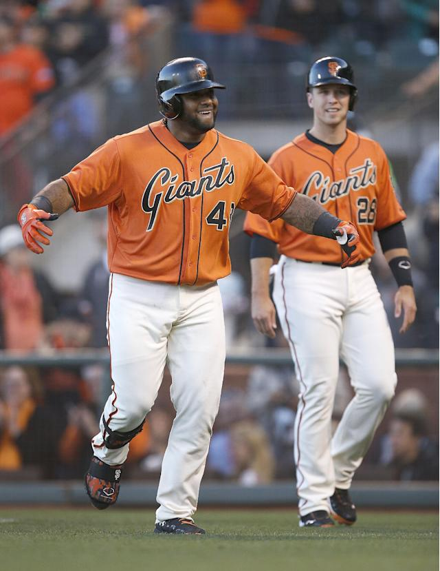 San Francisco Giants' Pablo Sandoval (48) celebrates with Buster Posey (28) after hitting a three-run home run off Minnesota Twins starting pitcher Kyle Gibson in the first inning of a baseball game Friday, May 23, 2014, in San Francisco. (AP Photo/Tony Avelar)