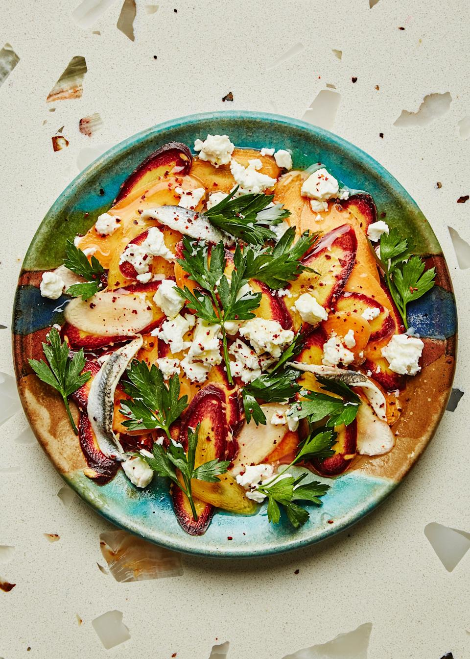 "The marinated white anchovies make this carrot salad stand out by adding a nice vinegary bite (if you opt for regular anchovies, season with less salt), and those little fishes are good for you, too! <a href=""https://www.bonappetit.com/recipe/carrot-salad-with-feta-and-anchovies?mbid=synd_yahoo_rss"" rel=""nofollow noopener"" target=""_blank"" data-ylk=""slk:See recipe."" class=""link rapid-noclick-resp"">See recipe.</a>"