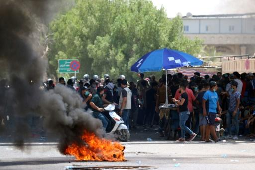Protesters burn tyres during a demonstration against unemployment and a lack of basic services, in the southern Iraqi city of Basra on July 15, 2018