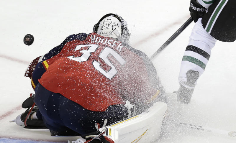 Florida Panthers goalie Michael Houser (35) blocks a shot of goal by the Dallas Stars during the second period of a preseason NHL hockey game, Friday, Sept. 20, 2013, in San Antonio. (AP Photo/Eric Gay)