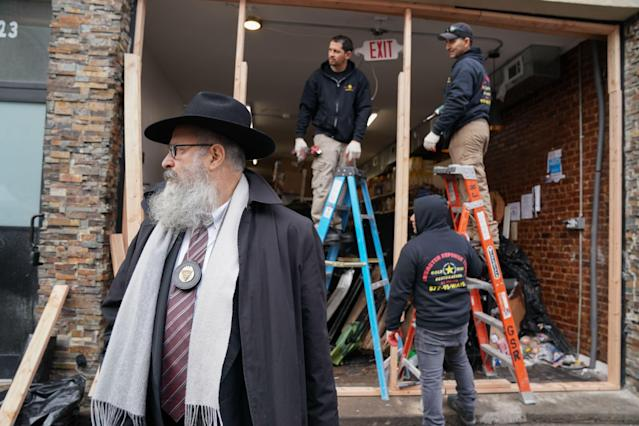 Demolition and recovery crews work at the scene of the Dec. 10 shooting at a Jewish deli in Jersey City, N.J. (Photo: Bryan R. Smith/AFP via Getty Images)