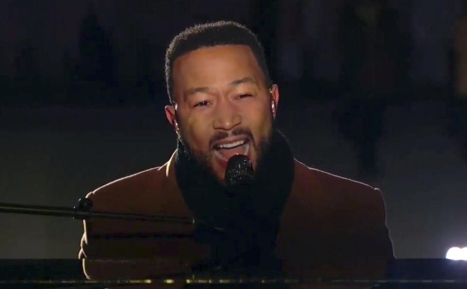 In this image from video, John Legend performs during the Celebrating America event on Wednesday, Jan. 20, 2021, following the inauguration of Joe Biden as the 46th president of the United States. (Biden Inaugural Committee via AP)