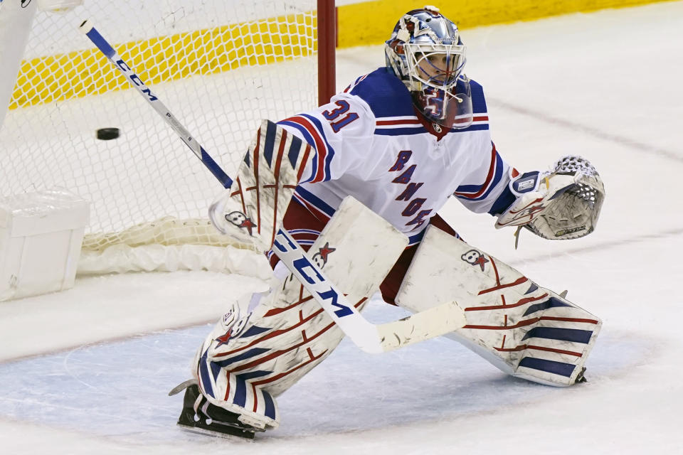 New York Rangers goaltender Igor Shesterkin (31) makes a save during the third period of an NHL hockey game against the New Jersey Devils, Tuesday, April 13, 2021, in Newark, N.J. The Rangers shut out the Devils 3-0. (AP Photo/Kathy Willens)