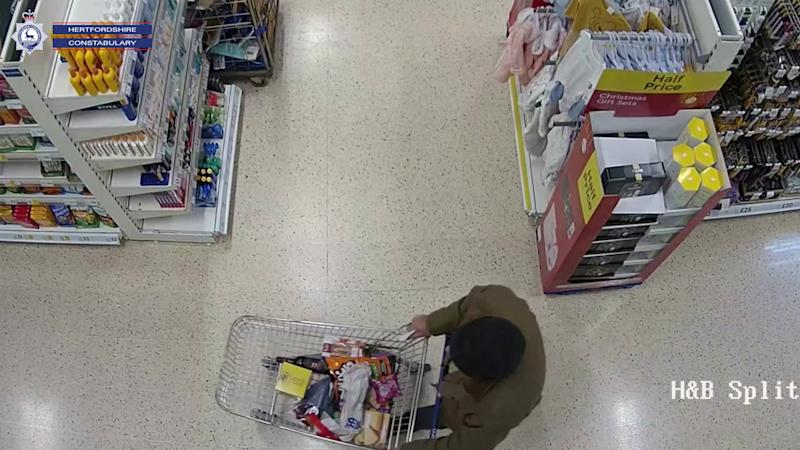 Wright seen on CCTV as he moves around a Tesco. (SWNS)