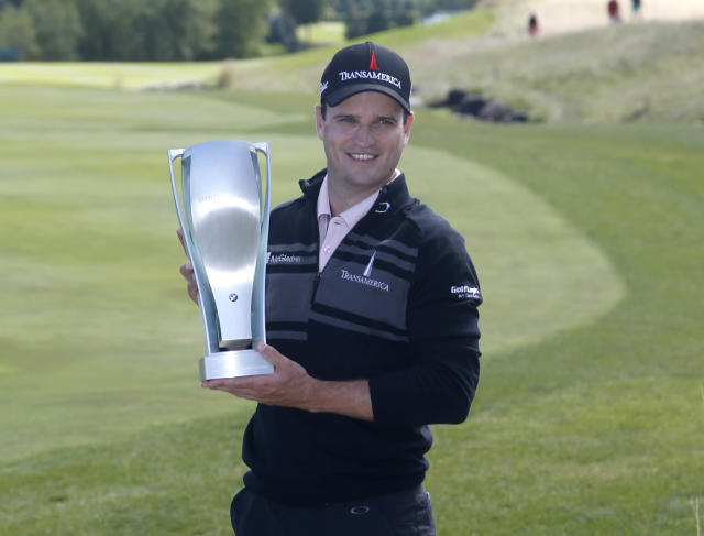 Zach Johnson poses with the BMW Championship trophy after winning the BMW Championship golf tournament at Conway Farms Golf Club in Lake Forest, Ill., Monday, Sept. 16, 2013. (AP Photo/Charles Rex Arbogast)