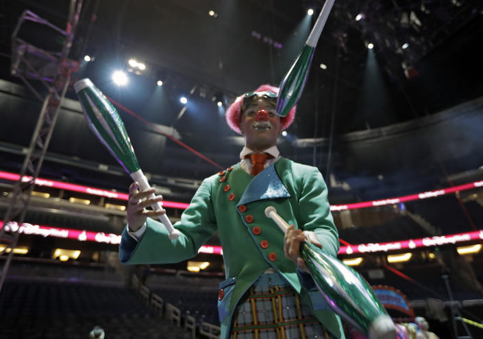 """A Ringling Bros. and Barnum & Bailey clown juggles for fans during a pre show Saturday, Jan. 14, 2017, in Orlando, Fla. The Ringling Bros. and Barnum & Bailey Circus will end the """"The Greatest Show on Earth"""" in May, following a 146-year run of performances. Kenneth Feld, the chairman and CEO of Feld Entertainment, which owns the circus, told The Associated Press, declining attendance combined with high operating costs are among the reasons for closing. (AP Photo/Chris O'Meara)"""