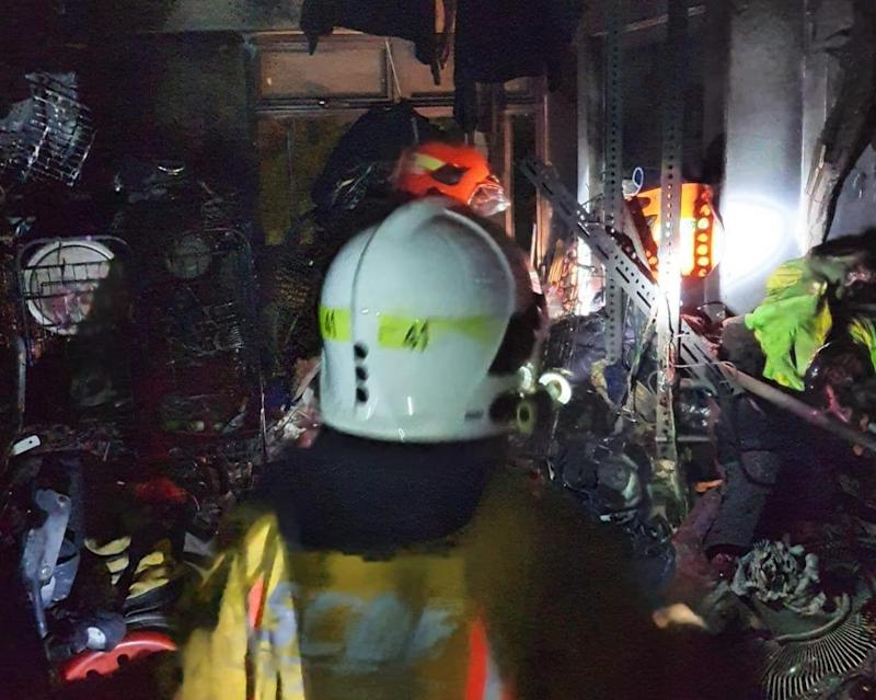 SCDF firefighters at a Block 210A Bukit Batok flat following a fire there on 1 November 2019. PHOTO: SCDF