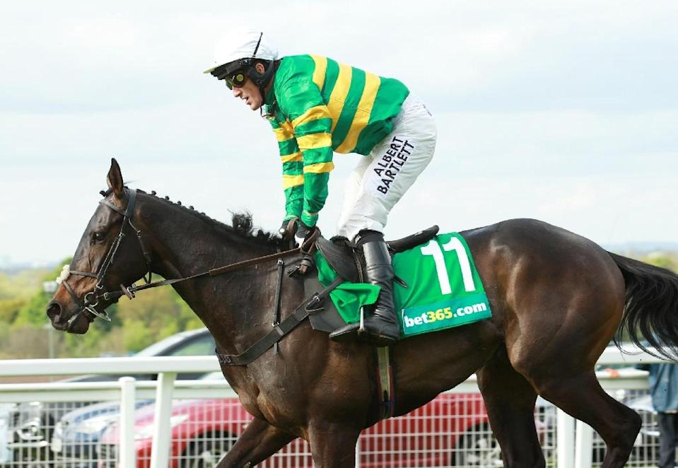 Northern Irish jockey Tony McCoy rides horse Box Office to finish third at Sandown Park Racecourse in Esher, southern England, on April 25, 2015 in the final race of his career (AFP Photo/Sean Dempsey)