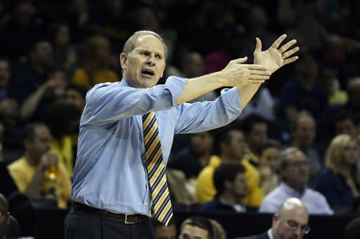 Michigan head coach John Beilein yells to his players in the first half of a NCAA college basketball game against West Virginia at the Barclays Center, Saturday, Dec. 15, 2012, in New York. (AP Photo/John Minchillo)