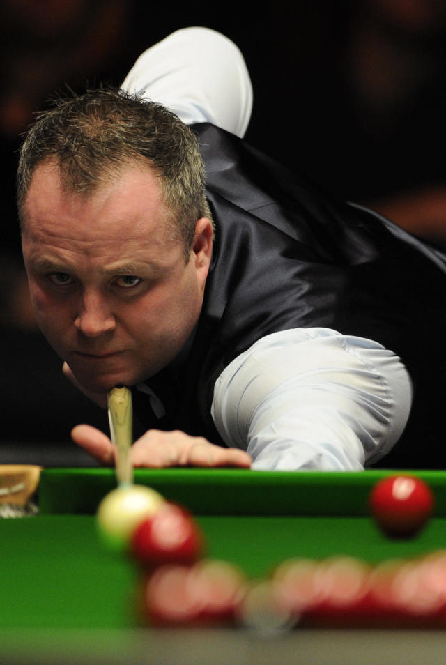 John Higgins of Scotland plays a shot against Shaun Murphy of England during the semi-final match in the BGC Masters snooker tournament at Alexandra Palace in north London on January 21, 2012s. AFP PHOTO / CARL COURT (Photo credit should read CARL COURT/AFP/Getty Images)