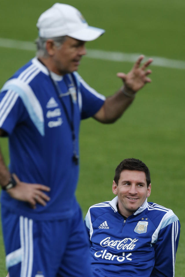 Argentina's Lionel Messi, bottom, listens to Argentina's head coach Alejandro Sabella, left, during a training session in Vespesiano, near Belo Horizonte, Brazil, Wednesday, July 2, 2014. On Saturday, Argentina will face Belgium in their World Cup soccer match quarterfinal. (AP Photo/Victor R. Caivano)